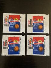 1986-87 Fleer NBA Basketball four (4) wax pack Wrappers. Jordan Rookie Card year