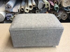 footstool / pouffe upholstered in grey fabric