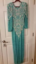 Vintage beaded 80s gown. Heavy beading antique dress with golden girl glam!