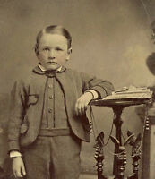1/6 PLATE ANTIQUE TINTYPE PHOTO PORTRAIT OF A BOY WITH STEREOVIEW CARDS ON TABLE