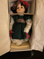 marie osmond porcelain toddler dolls Olive May Christmas.  Cute!