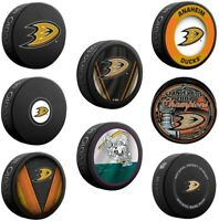 Anaheim Ducks Collectors Package of (7) NHL Team Logo Souvenir Hockey Pucks
