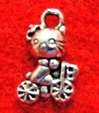 100Pcs. WHOLESALE Tibetan Silver Kitty CAT On Bike Charms Earring Drops Q1302