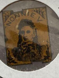 Tin Tobacco Tag Nonnie V Rectangular Black On Orangish Picture Of A Girl Rare