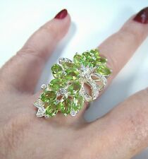 PERIDOT & WHITE SAPPHIRE RIBBON RING 8.64 CTW - WHITE GOLD over 925 SILVER