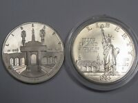 2 Silver Commemorative Dollars: 1984 Proof & 1986-p BU.  #22