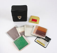 LOT OF TEN MOSTLY-SQUARE FILTERS, IN AMBICO CASE/208010