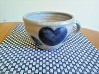A SMALL POTTERY CROCK/CUP WITH A COBALT HEART.