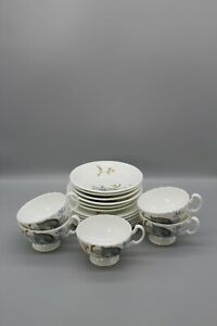 Unbranded vintage tea set with scalloped rim cups, blue and yellow leaf design