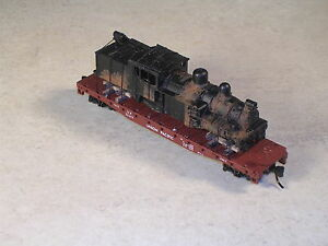 N Scale 50 Foot Flat Car with rusted out logging shay locomotive. version #5