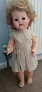 Vintage walking  doll, 1950s plastic