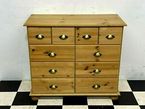 Modern pine multi drawer chest of drawers with brass finish handles Delivery
