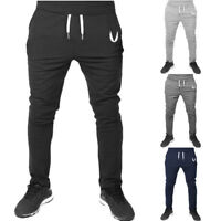 Mens Sportswear Casual Cotton Elastic Fitness Solid Running Gym Pants Trousers