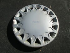one 1990 to 1992 Mazda 626 hubcap wheel cover