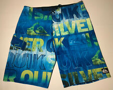 New listing Quicksilver Mens Size 34 Board Shorts Swim Trunks Blue Yellow Wave Logo Graphics