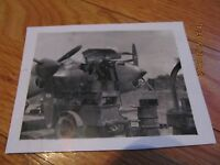 WWII  AIRPLANE B/W SNAPSHOT PHOTOGRAPH Loading Artillery in the Plane LAMINATED
