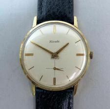 VINTAGE GENTS 9 CT GOLD NIVADA 17 JEWEL MANUAL WIND WATCH C.1964 IN G.W.O.