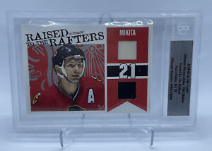 Stan Mikita 2004-05 ITG Ultimate Memorabilia Raised To The Rafters /25