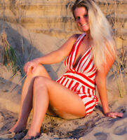 Red & white double-breasted shorts romper by Alythea
