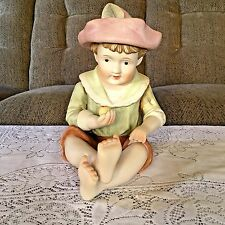 """Antique German 12"""" Bisque Piano Baby wearing  Hat with Feather Holding Apple"""