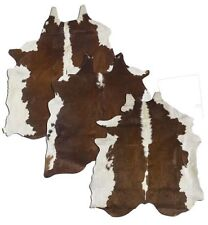LG/XL Brazilian Hereford hair on cowhide rug.  approximately 42.5 - 50 sq.ft