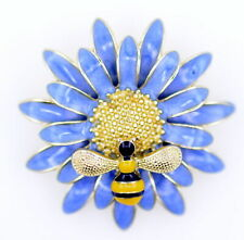 Small bee on a large blue daisy brooch. Gold trim and enamel flower and bee