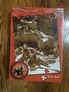 MasterPieces Bone Bed Mammoth Site 550 Piece Jigsaw Puzzle Sealed.