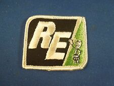 Vintage RE Electric Company Logo With Cord Plug Cartoon Iron On Patch