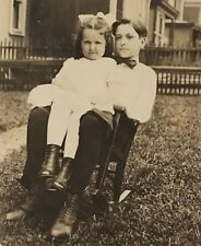 Real Photo RPPC ~ Boy w Bow Tie & Little Sister In Lap on Small Rocking Chair