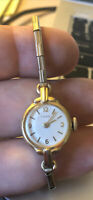 Vintage Ladies Women's Working Timex Wind Up Watch-Stretch Thin Gold Tone Band