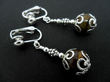 A PAIR OF DANGLY TIGERS EYE BEAD  SILVER PLATED DROP CLIP ON EARRINGS.