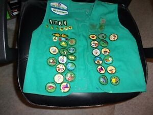 GIRL SCOUTS GREEN VEST WITH 60 PATCHES PLUS PINS FROM EARLY 2000s