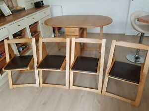 Debenhams Light oak fold Away Table And Chairs can deliver for a delivery charge