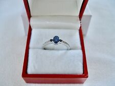 .63 Ct. Sapphire '3 Stone' and Diamonds  10k White Gold Ring