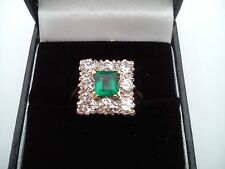 emerald and diamond set cluster ring.