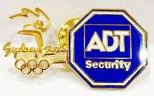 ADT SECURITY GOLD SYDNEY OLYMPIC GAMES 2000 PIN BADGE COLLECT #773