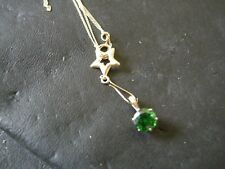 18CT GOLD EMERALD PENDANT ON AN 18CT GOLD CHAIN