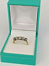 A Diamond Gold eternity ring set with five old cut diamonds
