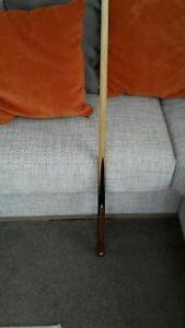 Used snooker cues