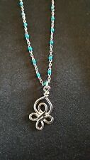 Silver tone and green Celtic knot necklace