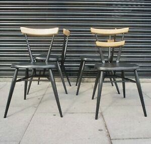 4x adult black painted vintage 1960s Ercol single/two bar stacking dining chairs