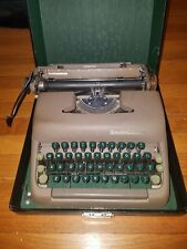 Antique Smith-Corona Sterling typewriter with case.