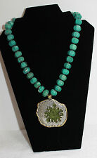 TURQUOISE COLORED STONE BEAD NECKLACE WITH LARGE METAL PENDANT