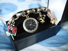 Armitron Women's 75/3724BKGP 7 Charms Bracelet Gold-Tone Watch