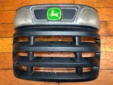 John Deere X500 grille + lense  M156940, M152322