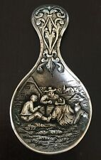 Image of Dutch Men Laying in a Field Silver Tea Caddy/ Spoon (Sp 16)