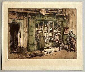Aquatinte originale Armand Coussens (1881-1935) Le brocanteur Antiquités 1912