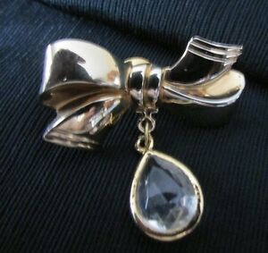 DANGLING WHITE PEAR SHAPED STONE CHARM  RIBBON GOLD TONE WITH BROOCH  PIN