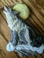 """Resin timber wolf on snow howling at moon ornament, 4 1/8"""" l, 3 1/8"""" w"""