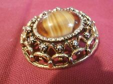 Filigree costume jewelry brooch gold tone, resin centre